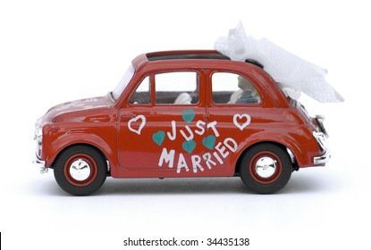 Classic Italian Car 'just married'. isolated on white.