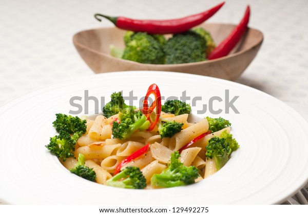 classic Italian penne pasta with broccoli and red chili pepper