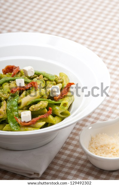 classic Italian penne pasta with sundried tomato and basil