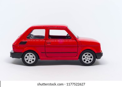 Classic Italian small toy auto in red on a white background