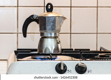 Classic Italian style moka coffee pot on the gas stove with fire