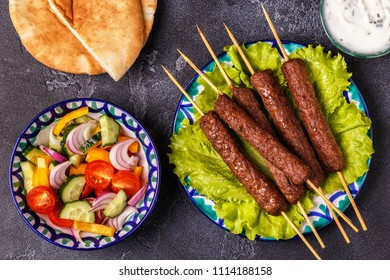 Classic kebabs on the plate. Top view.