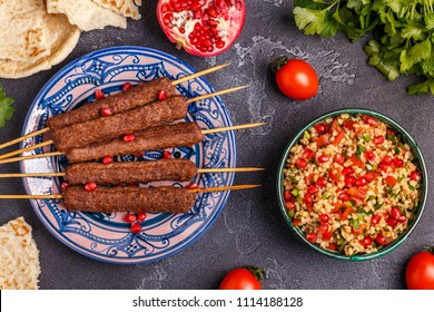 Classic kebabs with tabbouleh salad, traditional middle eastern or arab dish. Top view.