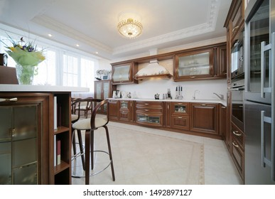Classic kitchen interior with brown furniture