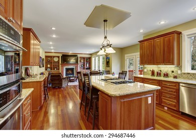 Classic kitchen with marble counters and hardwood floor.