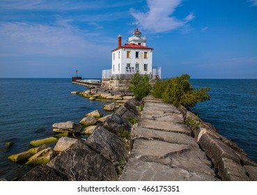 A classic Lake Erie lighthouse, The Fairport Harbor West Breakwater Light on a beautiful day in Fairport Ohio, USA
