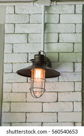 Classic lamp on the white brick wall