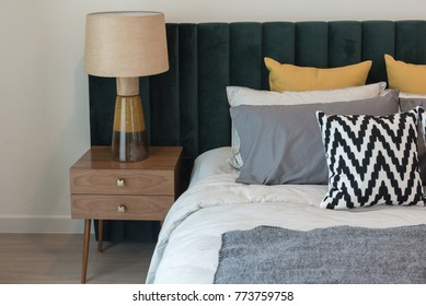classic lamp on wooden table side in classic bedroom style, interior design concept