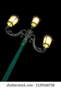 Classic lamp post at night on Venetian street. Venice, Italy