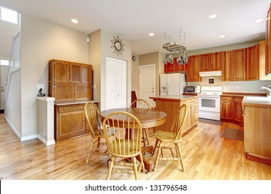 Classic large wood kitchen interior with hardwood floor, breakfast table.
