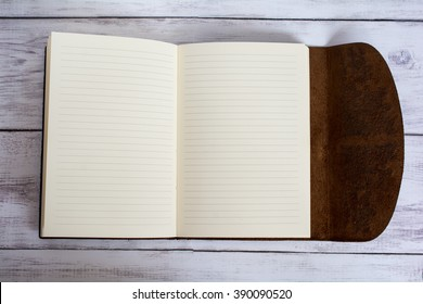 Classic Leather Bound Journal Book Fully Open on a White Barn Board Floor