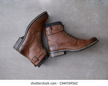 Classic leather elegant fashion on boots shoes on gray background.