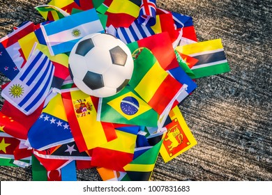 Classic leather soccer ball with nations teams flags of the participating countries in the tournament.