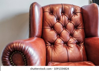 classic leather upholstered armchair in red-brown colour