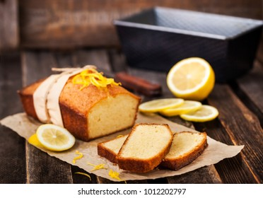 Classic lemon pound cake on rustic wooden background