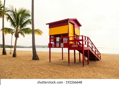 Classic lifeguard station on empty tropical beach on cloudy day in low season