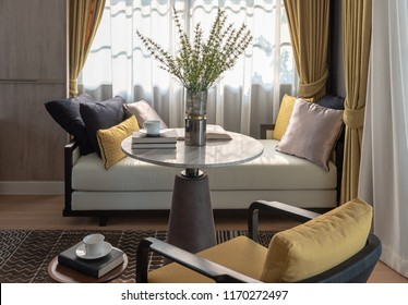classic living room style with plants in vase on round table and set of sofa,interior design decoration concept