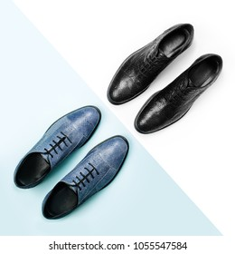 Classic male black and blue leather shoes on a white. Male fashion concept.  Flat lay, top view