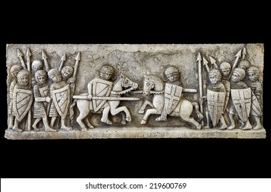 Classic medieval frieze showing a knights battle isolated on black background. Clipping path