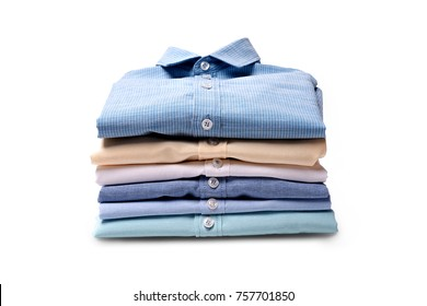 Classic men's shirts stacked on white background