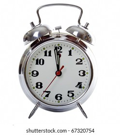 Classic metal alarm clock, isolated over a white background.