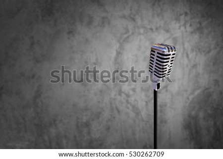 Classic microphone on blur raw cement stock photo edit now