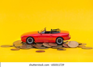 Classic of model red toy car park on stack golden coins. Saving, Financial and Installment payment concept.