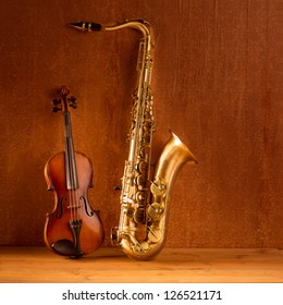 Classic music Sax tenor saxophone violin  in vintage wood background