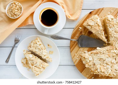 Classic Napoleon cake with coffee cup top view. Traditional millefeuille dessert with puff pastry and custard, russian cuisine treat, copy space