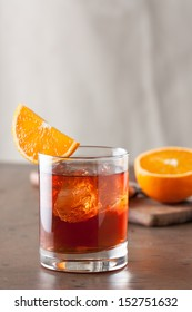 Classic negroni cocktail with an orange slice on wooden table