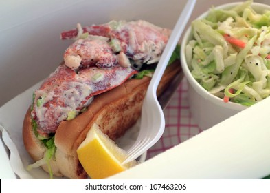 The classic New England lobster roll, served cold on a toasted bun with mayonnaise and celery. A side of coleslaw to go with it.