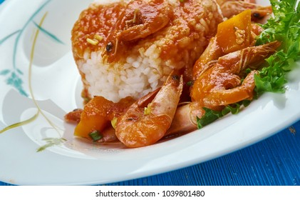 Classic New Orleans Shrimp Etouffee - Juicy shrimp dish smothered in rich and flavorful roux sauce .