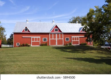 A classic North American red barn in early fall.