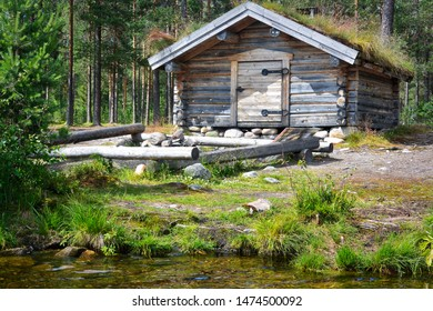 Classic Norwegian wooden cabin at the lakeside
