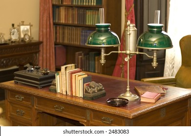 Classic oil lamp on antique office desk in historic George Brown House, Toronto, Ontario, Canada