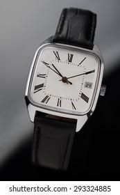 Classic old fashion wrist watch on black background
