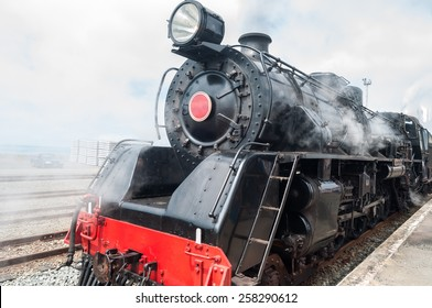 Classic old steam train in the station
