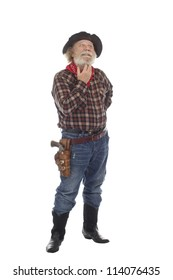 Classic Old West style cowboy with felt hat, grey whiskers, revolver, stands scratching his whiskers. Isolated on white background, copy space, vertical.