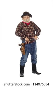 Classic Old West style cowboy with felt hat, grey whiskers, revolver, stands with thumbs hooked into belt.  Isolated on white background, copy space, vertical.