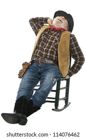 Classic Old West style laughing cowboy with felt hat, grey whiskers, revolver. He stretches leaning back in rocking chair. Isolated on white, vertical, copy space.