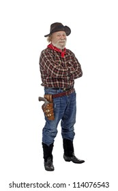 Classic Old West style smiling cowboy with felt hat, grey whiskers, revolver, stands with arms crossed. Isolated on white background, copy space, vertical.