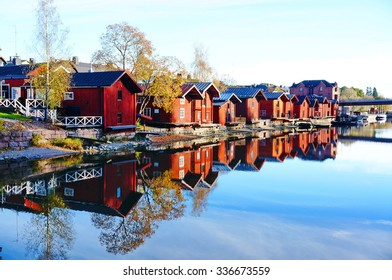 Classic old wood houses and their reflection in river, Porvoo Finland