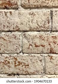 A classic orange brick wall painted white