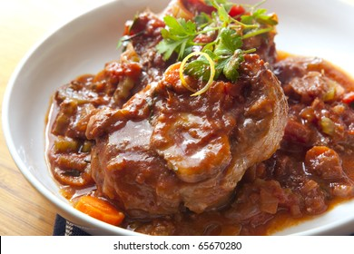 Classic osso buco.  Veal shanks slow cooked with tomatoes, carrots and onion.  Hearty, warming food.