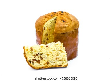Classic panettone with dried fruit ,traditional Italian Christmas cake on white background. In front a sliced part of cake.