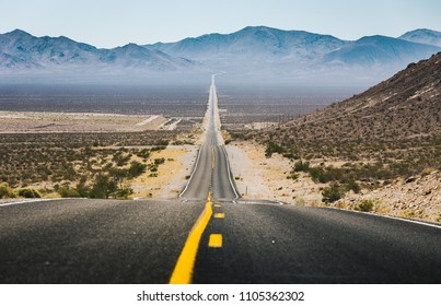 Classic panorama view of an empty long highway road in the American West on a beautiful sunny day in summer, USA, North America