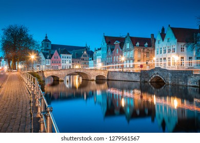 Classic panoramic twilight view of the historic city center of Brugge during beautiful evening blue hour at dusk, province of West Flanders, Belgium