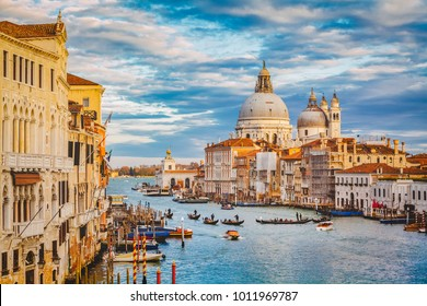 Classic panoramic view of famous Canal Grande with scenic Basilica di Santa Maria della Salute in beautiful golden evening light at sunset with retro vintage filter effect, Venice, Italy
