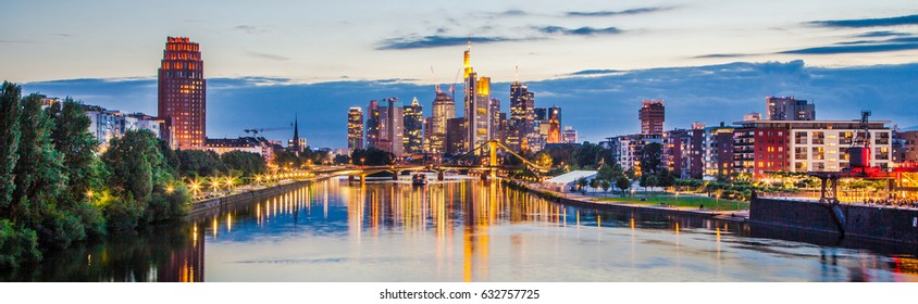 Classic panoramic view of famous Frankfurt am Main skyline with dramatic clouds in beautiful post sunset twilight during blue hour at dusk, Hessen, Germany