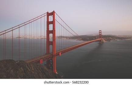 Classic panoramic view of famous Golden Gate Bridge seen from famous Battery Spencer viewpoint in beautiful post sunset twilight during blue hour at dusk in summer, San Francisco, California, USA